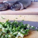 Ryby pieczone w ziemi -...