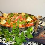 Paella z pomidorami i...